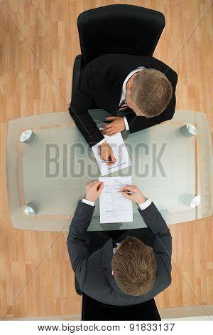 Businessmen Filling The Application Form