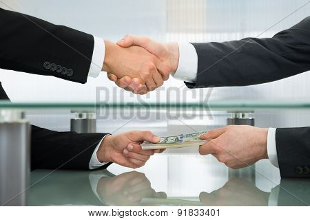 Businessman Accepting An Offer Of Money
