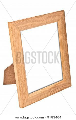 Blank wooden vertical photo frame isolated on white
