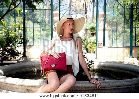 Blonde Woman Posing In Hat.