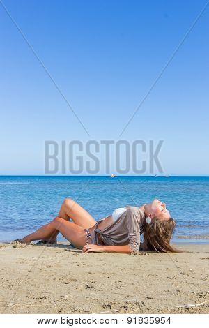 portrait of happy sexy girl in bikini posing at the beach