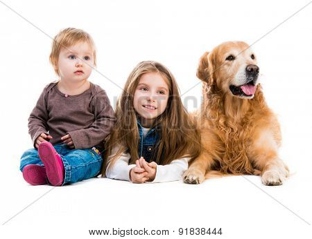 two happy  sisters  with her dog golden retriever in the studio. Isolated on white background