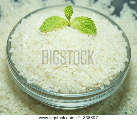 Bowl Of Raw Japanese Rice With Mint
