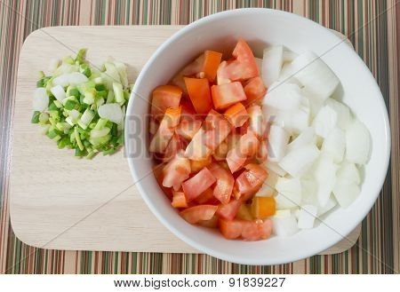 Cutting Board Of Chopped Tomatoes, Onions And Scallion