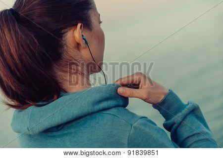 Sportswoman In Headphones Outdoor