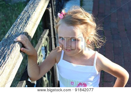 little fashionable girl with beautiful modern coiffure