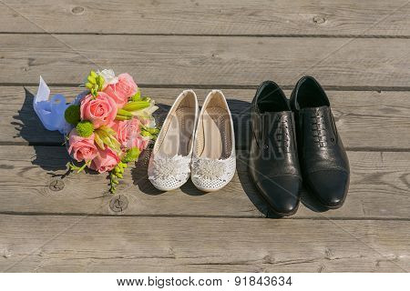 Bride and groom's shoe on the wooden floor