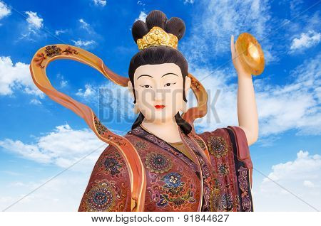 Chinese God On Blue Sky Background In Chinese Tample , Thailand