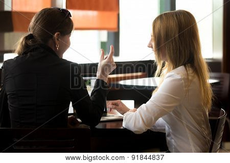 Coworkers Laughing Together