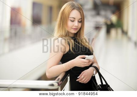 Young Woman Using App On Cellphone