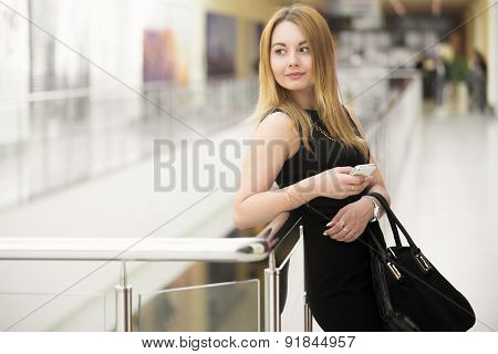 Young Woman Holding Smartphone