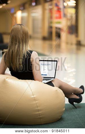 Young Woman Shopping Through Electronic App