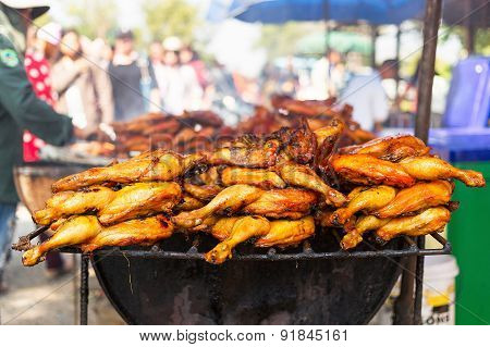 Chicken on grill.