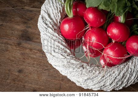 Radishes In A White Container On A Wooden Background