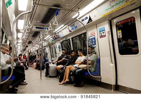 Riding The Commuter Train In Singapore