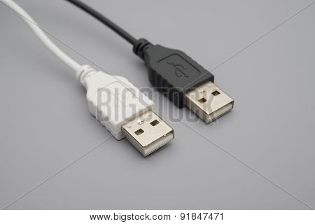 Black And White Usb Cables On Grey Background