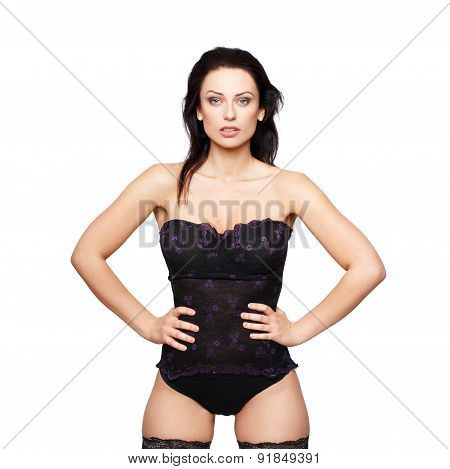 Sexy Woman In Corset Posing Isolated