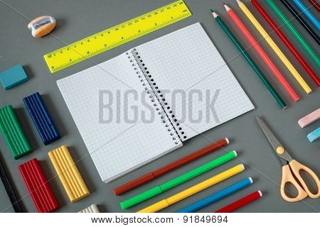 Nealty Organized Colorful School Supplies On Desk