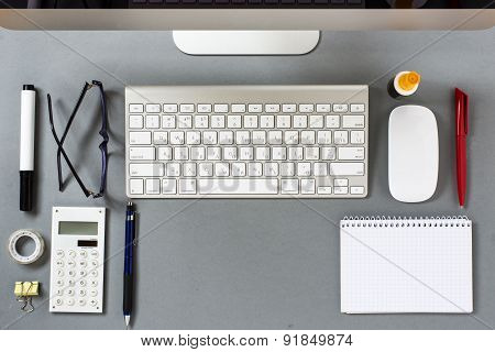 Grey Desk With Organized Supplies And Keyboard