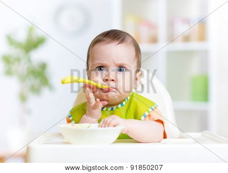 Funny Baby Eating Food On Kitchen