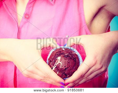 Woman Holds Chocolate Cake In Hand