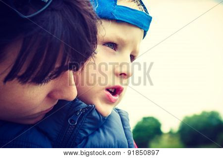 Closeup Of Child Kid With His Mother.