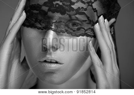 Woman With Gold Make Up And Lace On Face