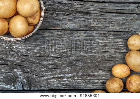 New Potatoes A Basket On A Vintage Wooden Background