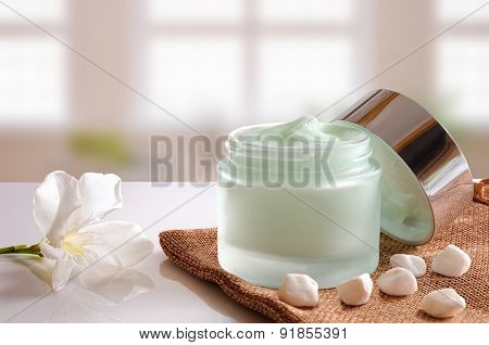Cream Jar Open On Burlap Front View Windows Background