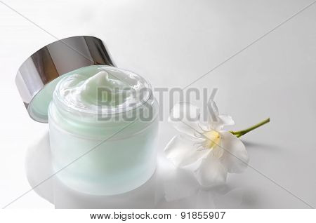 Cream Jar Open With Flower Top View Isolated