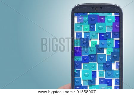 Blue smartphone and hear shapes. Idea for Valentines Day messages, love, lovers, love apps, Internet, blogs and others.