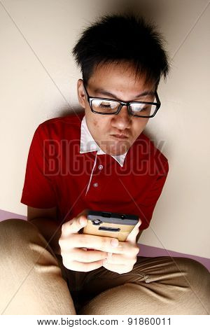 Teenage kid using a smartphone intensely
