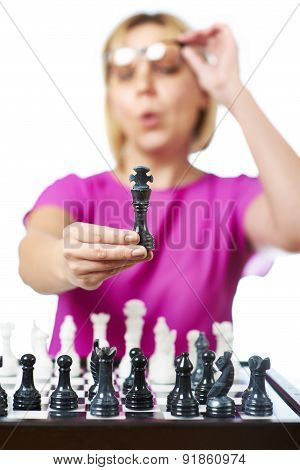 Woman In Glasses Showing Chess King Isolated