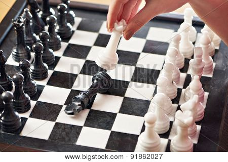 Hand With White Queen Hits Black King