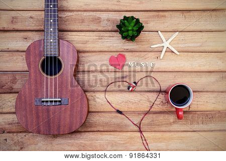 Cup Of Coffee With Ukulele On Old Wooden