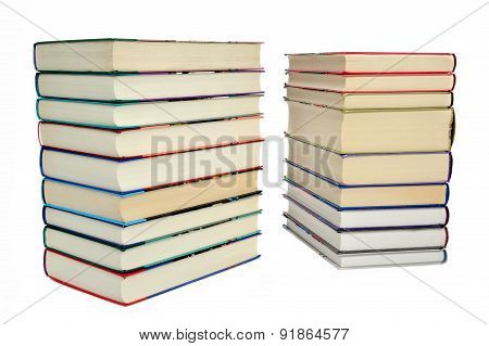 Two piles of books on a white background