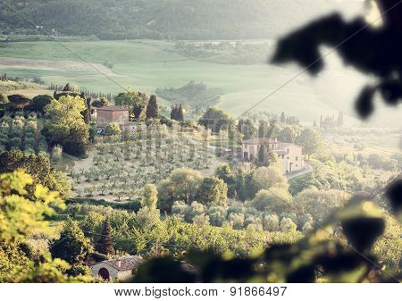 Landscape Of Tuscany Hills With Lens Flare