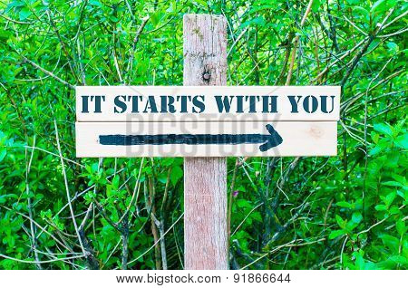 It Starts With You Directional Sign