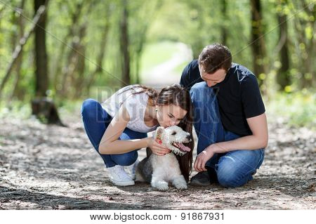 Happy young couple and  dog