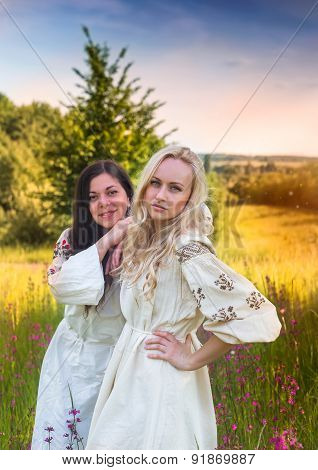 Two Ukrainian Girls In National Costumes At The Meadow