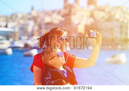mother and son making selfie while travel in Europe