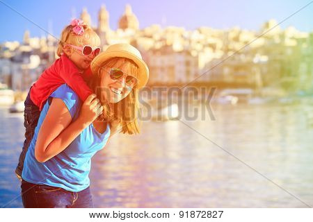 mother and daughter playing on the quay of Malta