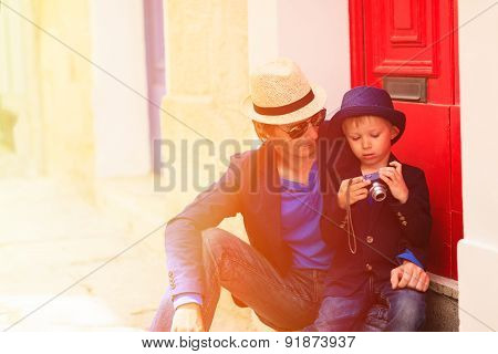 father and son travel in the city of Europe