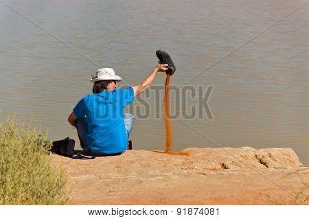 African desert adventure. Active man relaxing after hiking sand dunes of Namib desert