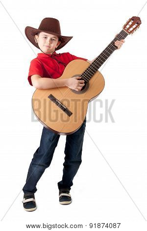 A Little Cowboy Standing With Guitar