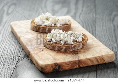 rye sandwich or bruschetta with ricotta cheese and herbs