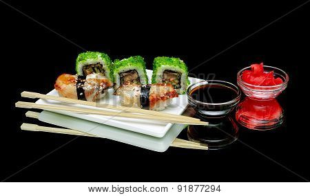 Sushi And Rolls On A Plate On A Black Background