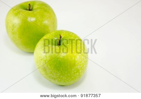 Two Green Apples On White