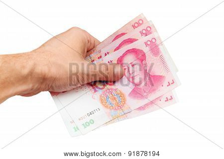 Chinese Yuan Renminbi Banknotes In Hand Isolated