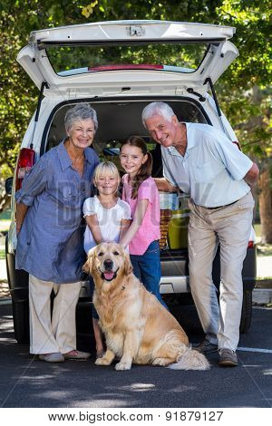 Grandparents going on road trip with grandchildren on a sunny day